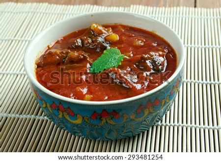 Laal maans - meat curry from Rajasthan, India. mutton curry prepared in a sauce of curd and hot spices such as red chillies - stock photo