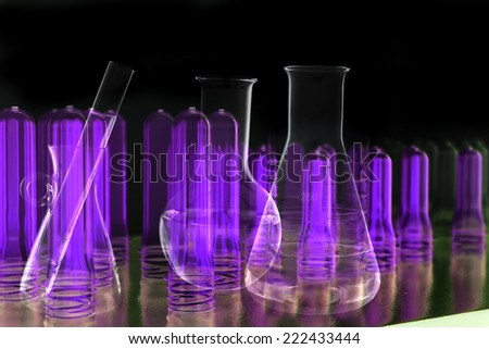 Lab equipment and tube in black light  - stock photo