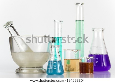 Lab equipment, glassware kit filled with various colored liquids and gels