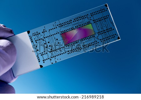 Lab on chip (LOC) is  device that integrates  laboratory functions on  nano chip - stock photo