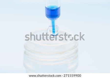 Lab research with fluids. Conceptual image of clinical testing, scientific analysis and health science. - stock photo