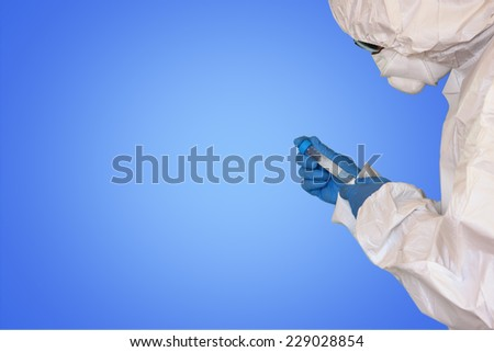 Lab scientist in safety suit With in test tube