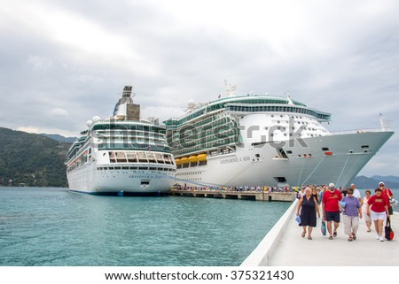 Labadee, Haiti, February 06, 2015: Two Royal Caribbean Cruise ships Independence of the Seas and Grandeur of the Seas docked in Labadee Haiti with passengers disembarking.
