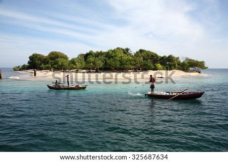 LABADEE, HAITI - SEPTEMBER 27, 2015: Fishermen fishing in their boats in the Western Caribbean Waters of Labadee, Haiti. - stock photo