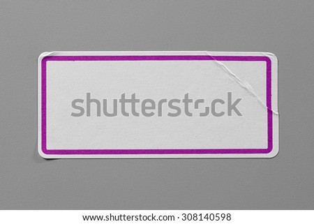 Label Adhesive Close Up on Grey Background with Real Shadow. Top View of Adhesive Paper Tag with Pink Border. Stickers with Copy Space for Text or Image - stock photo