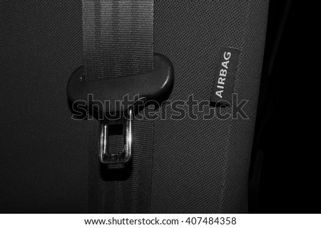 label image on the automotive seat air bag device for safety in the car with the hook of the side seat belt - stock photo