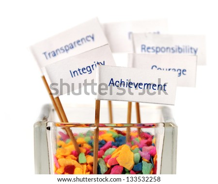 "Label of ""Achievement"" pin into the glass of color stone / Business core value, Business strategy, Key success factor, Mission, Vision - stock photo"