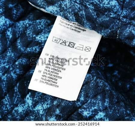 Label on clothing close-up  - stock photo