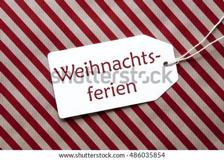 Label On Red Wrapping Paper, Weihnachtsferien Means Christmas Break