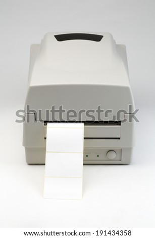 Label printer with blank message ready to insert message of your choice. The image is on a gray background - stock photo
