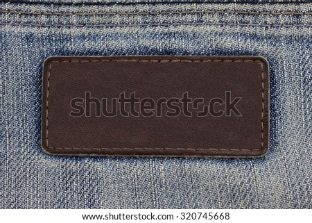 label sewed on a blue jeans - stock photo
