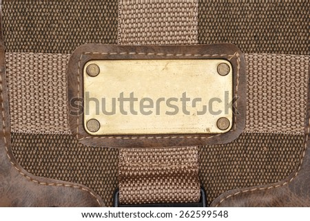 label steel color gold on cloth - stock photo