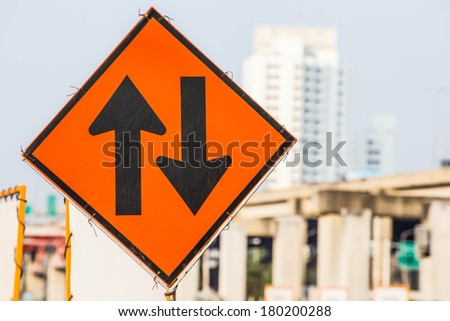 Label the arrow on the road construction site,Old sign contracts - stock photo