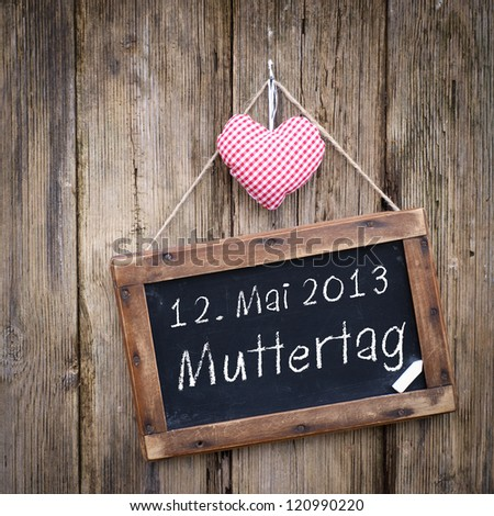 Label with german text: May 12, mother's day - stock photo