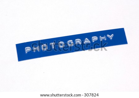 Label With Photography Embossed on It.