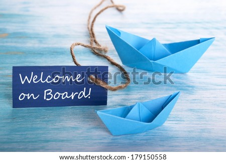Label with Welcome on Board and Boats as Background - stock photo