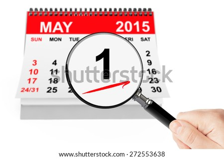 Labor day Concept. 1 may 2015 calendar with magnifier on a white background - stock photo