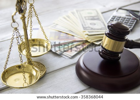Labor law concept, scale, gavel, money and calculator - stock photo