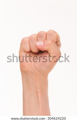 Labor movement, workers union strike concept with male fist isolated on white background raised in the air fighting for their rights. - stock photo