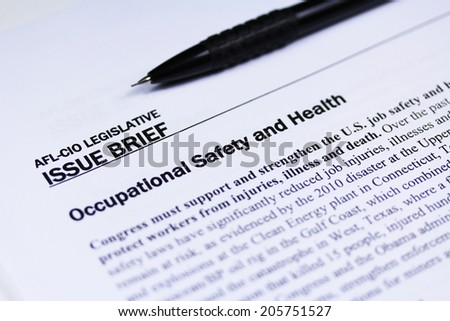 Labor safety text close up with a pen