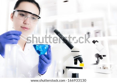 laboratory assistant analyzing a sample - stock photo