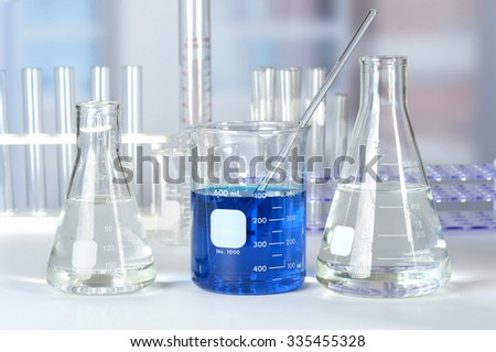 Laboratory beakers, flasks, and test tubes on lab table