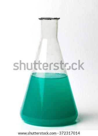 laboratory flask with a green liquid