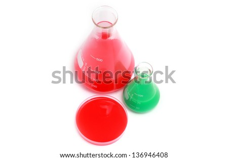 laboratory flasks with chemical solutions over white background