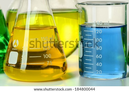 Laboratory Flasks with Colorful Liquids - stock photo