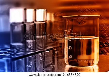 Laboratory glassware, beaker and test tubes in rack  - stock photo