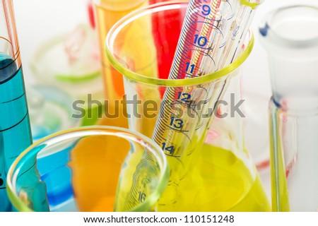 Laboratory glassware close up on white background - stock photo