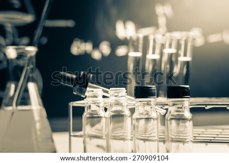 Laboratory glassware containing chemical liquid, science research - stock photo