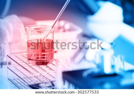 Laboratory glassware containing chemical liquid, science research