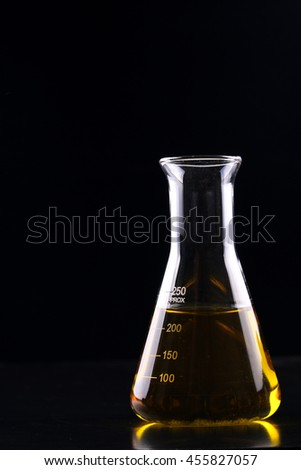 Laboratory glassware filled with yellow reagent