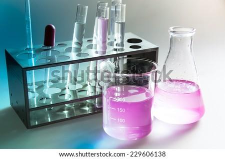 Laboratory glassware in chemical lab. - stock photo