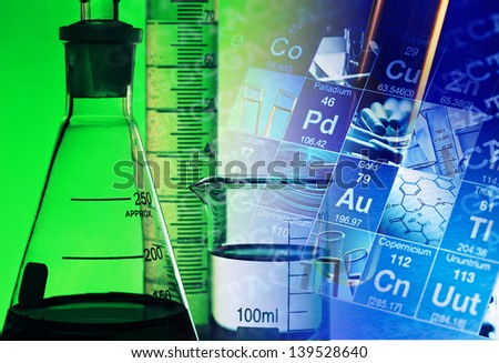 Laboratory glassware in green light. Science concept. - stock photo