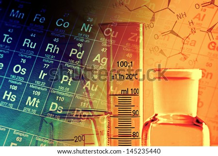 Laboratory glassware in yellow light. Science concept. - stock photo