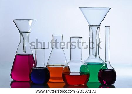 laboratory  glassware isolated on blue - stock photo