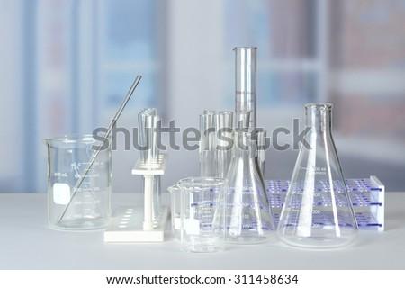 Laboratory glassware on lab table - stock photo