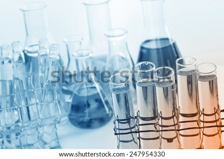 Laboratory glassware, test tubes and flasks with clear solution.  - stock photo