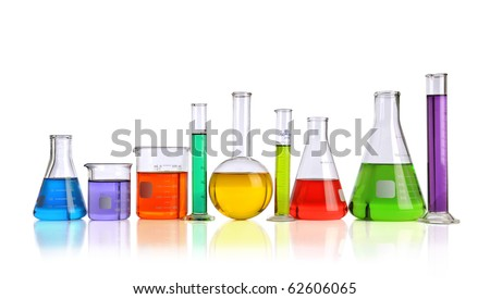 Laboratory glassware with liquids of different colors with reflections on table - With clipping path