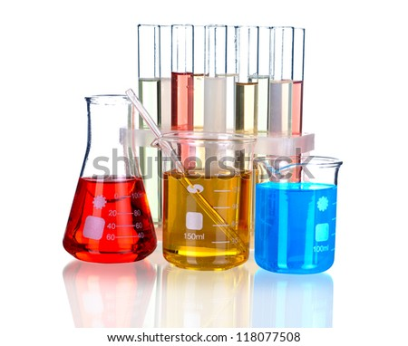Laboratory glassware with reflections on table isolated over white background - stock photo