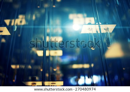 Laboratory rack with glass tubes soil samples, laboratory testing, abstract disposition, blue flare light - stock photo
