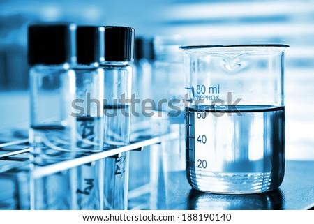 Laboratory research, chemical liquid in laboratory glassware - stock photo