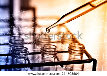 Laboratory research, dropping liquid to test tubes  - stock photo