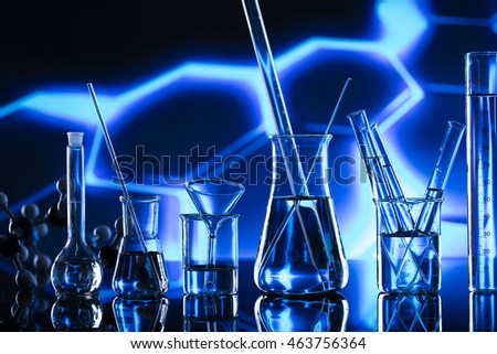 Laboratory research, flask containing chemical liquid with microscope