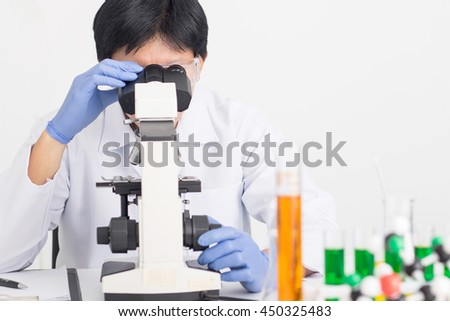 Laboratory research medical scientist lab ,scientist people looking microscope for analyzing in test lab room.