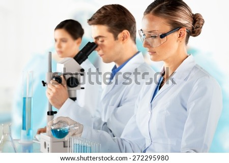 Laboratory. Scientists are working in a chemical lab. - stock photo