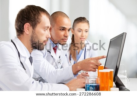Laboratory. Scientists working on computer in laboratory. - stock photo