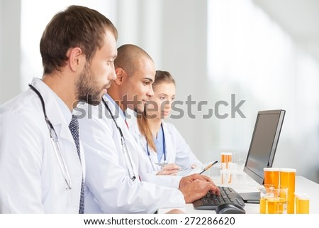 Laboratory. Scientists working on computer in the laboratory. - stock photo